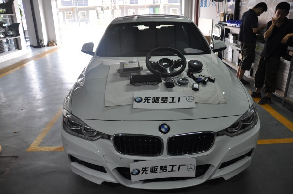 武汉宝马改装 宝马3系 328M方向盘+旋钮+EVO主机+碳纤后视镜